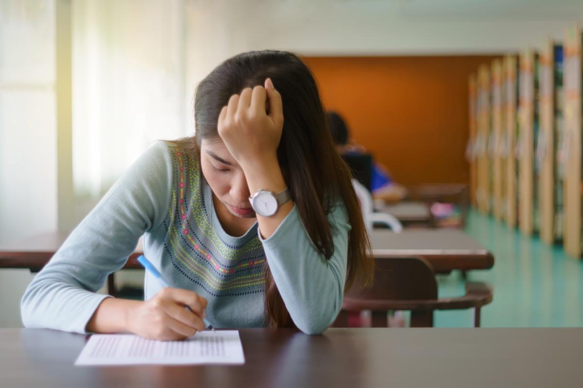 Tired girl taking test