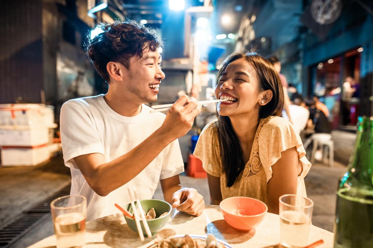couple enjoying street food in Hong Kong