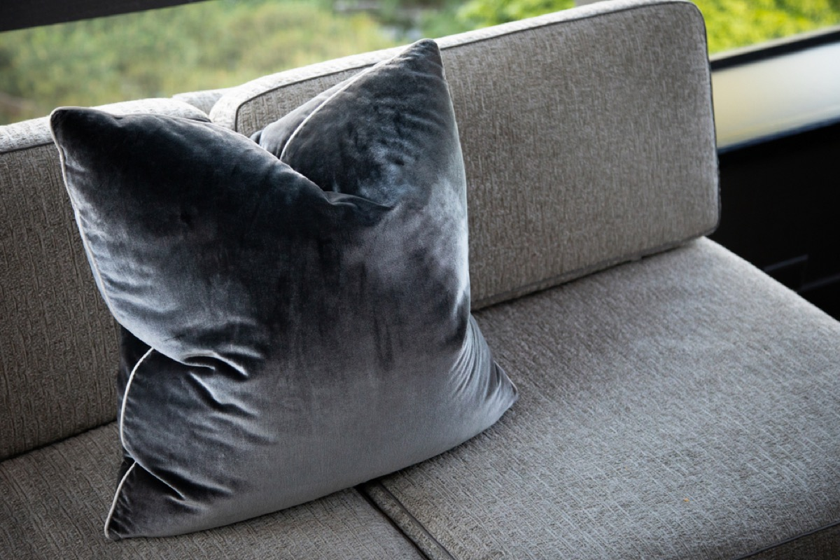 gray pillow on gray couch