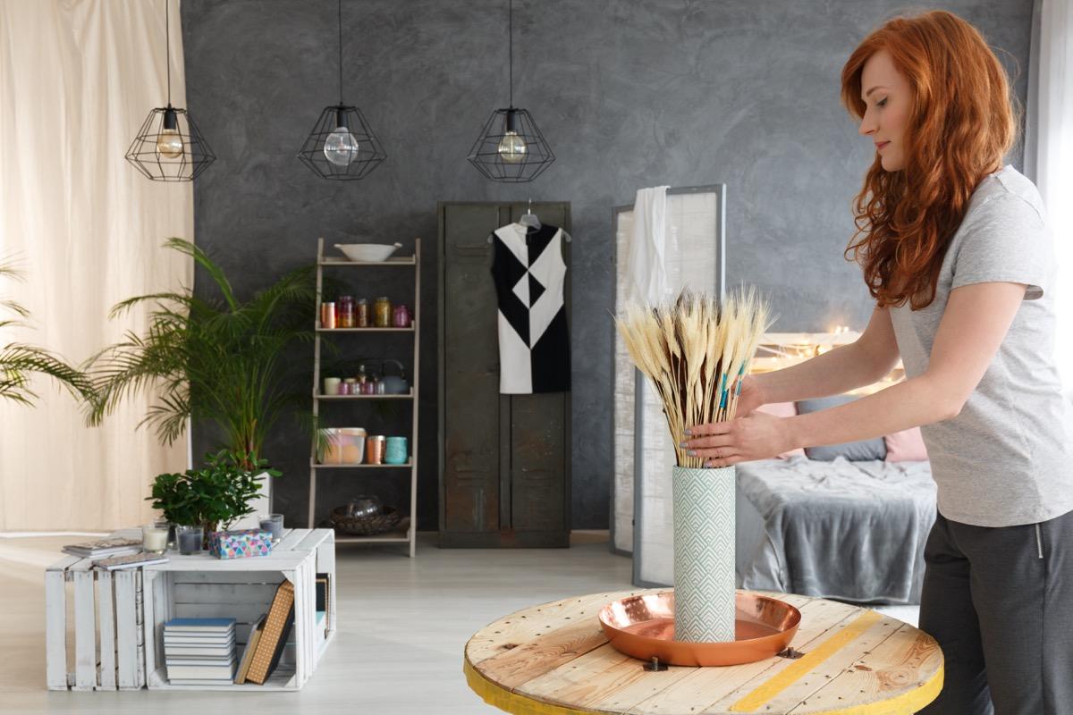 woman designing apartment celebrity home design tricks