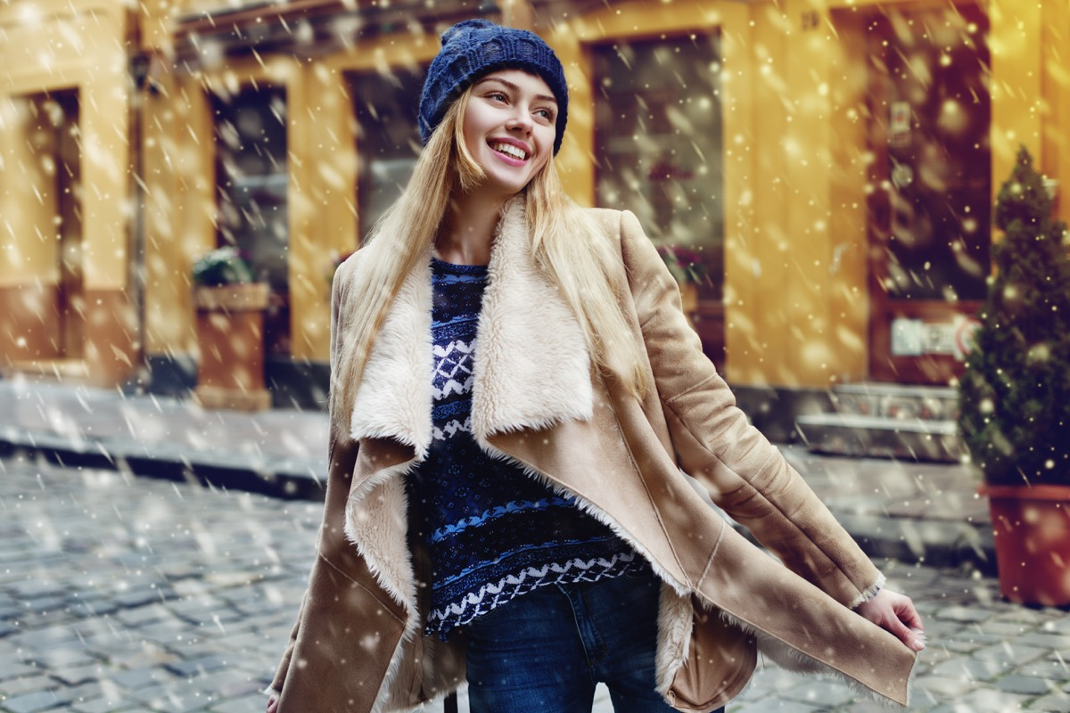 Woman happy in the snow christmas depression