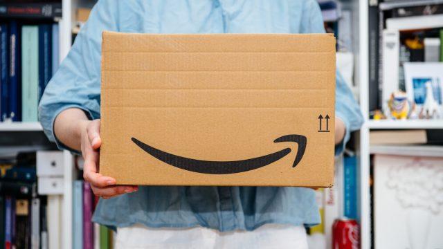 woman holding an amazon prime box - amazon prime day deals
