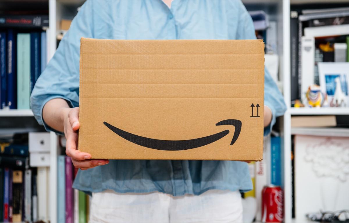 woman holding an amazon prime box - amazon black friday deals