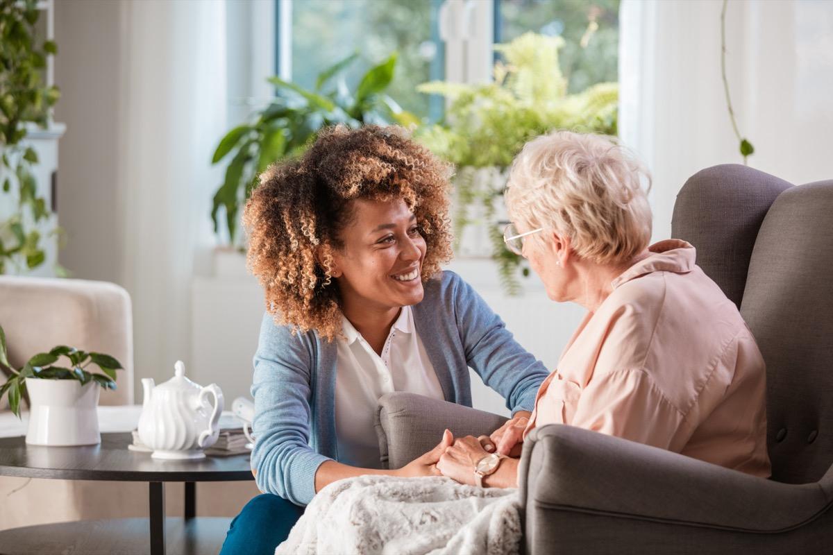 woman talking to elderly woman in a nursing home