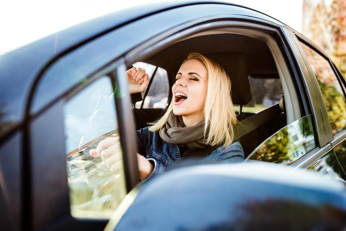 Woman singing in car