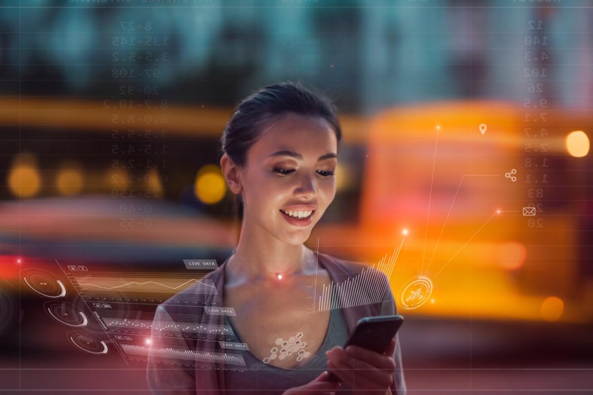 woman using a futuristic smartphone - exciting future predictions