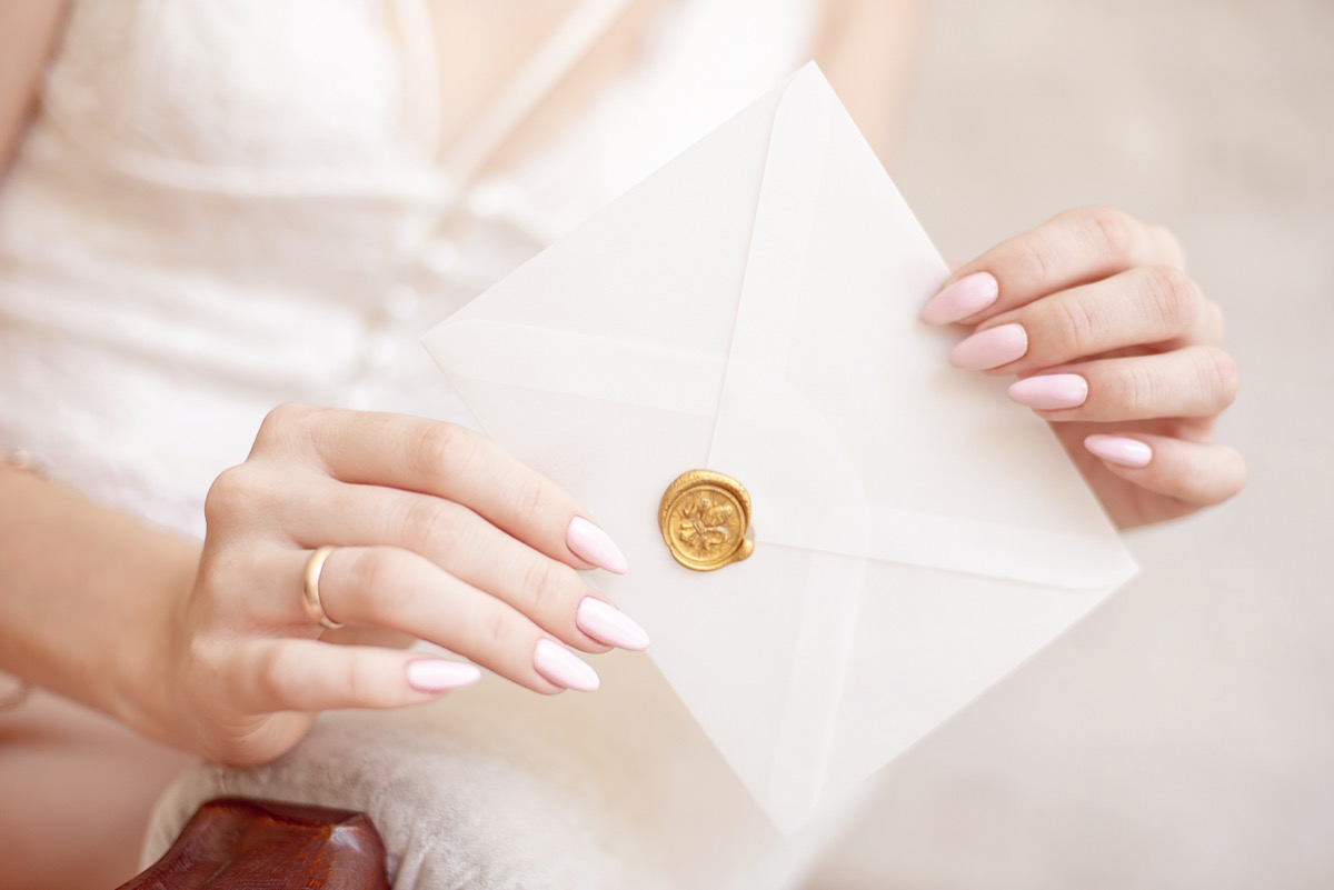 woman with rsvp invitation in hand