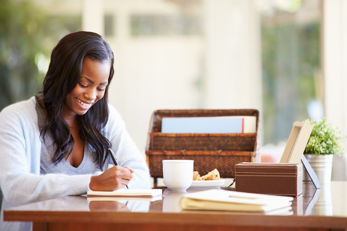 woman writing in journal self-care tips