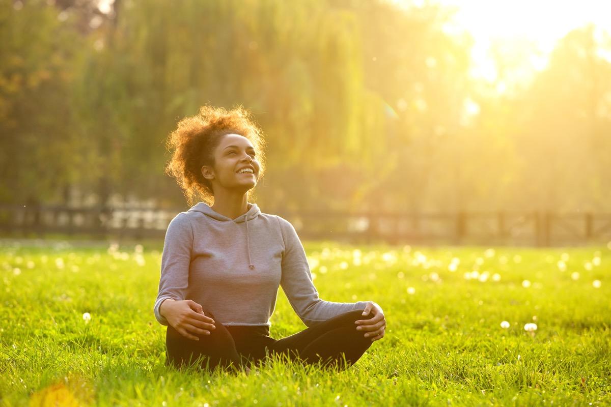 woman doing yoga affirmations