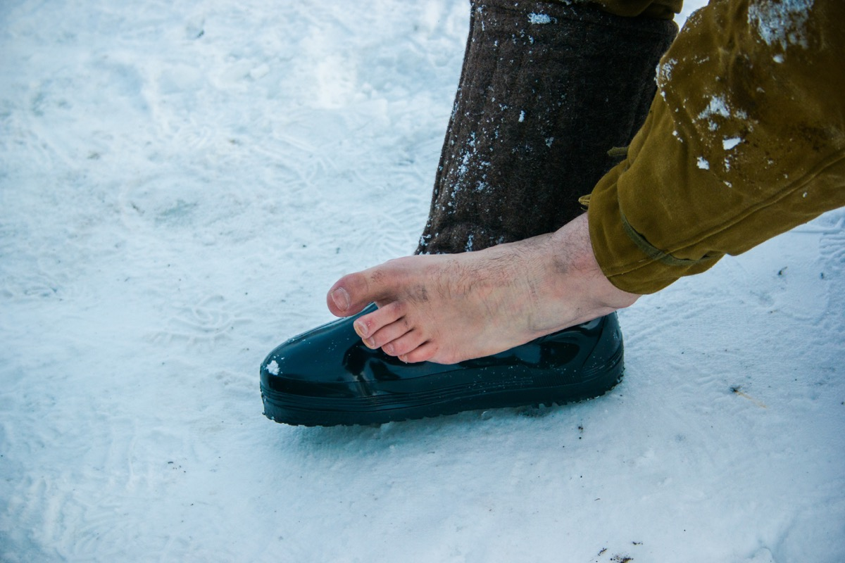 man with a foot injury in the winter