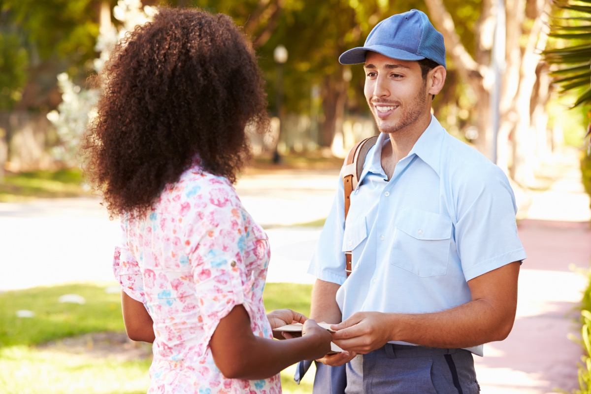 Mailman and woman talking