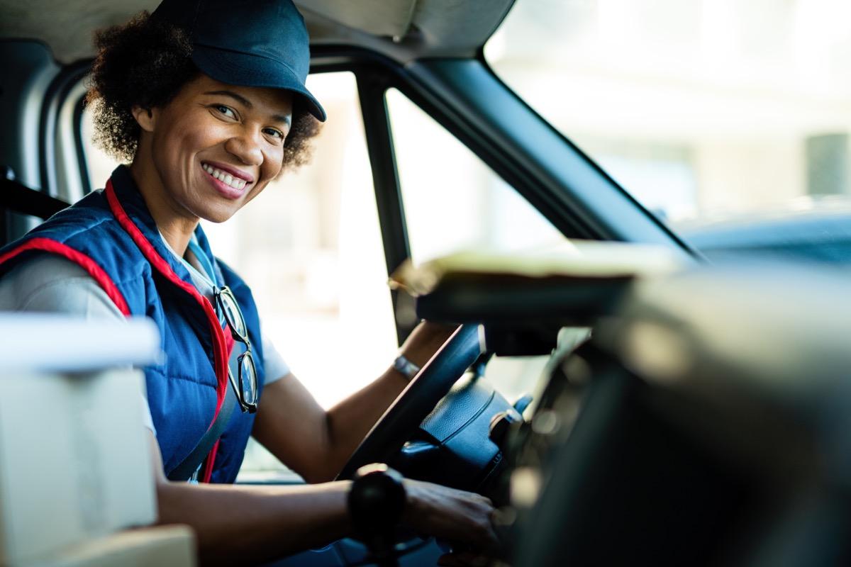 Mailwoman in truck