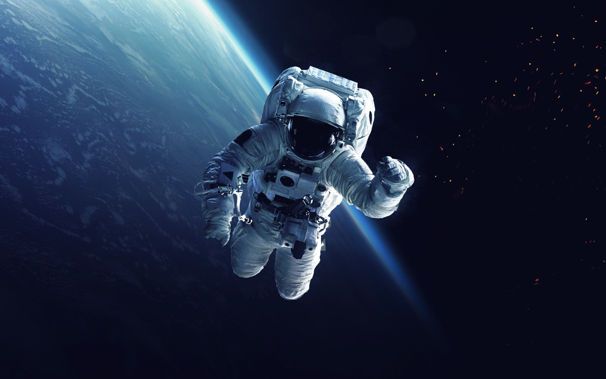 astronaut working in space with earth in the background