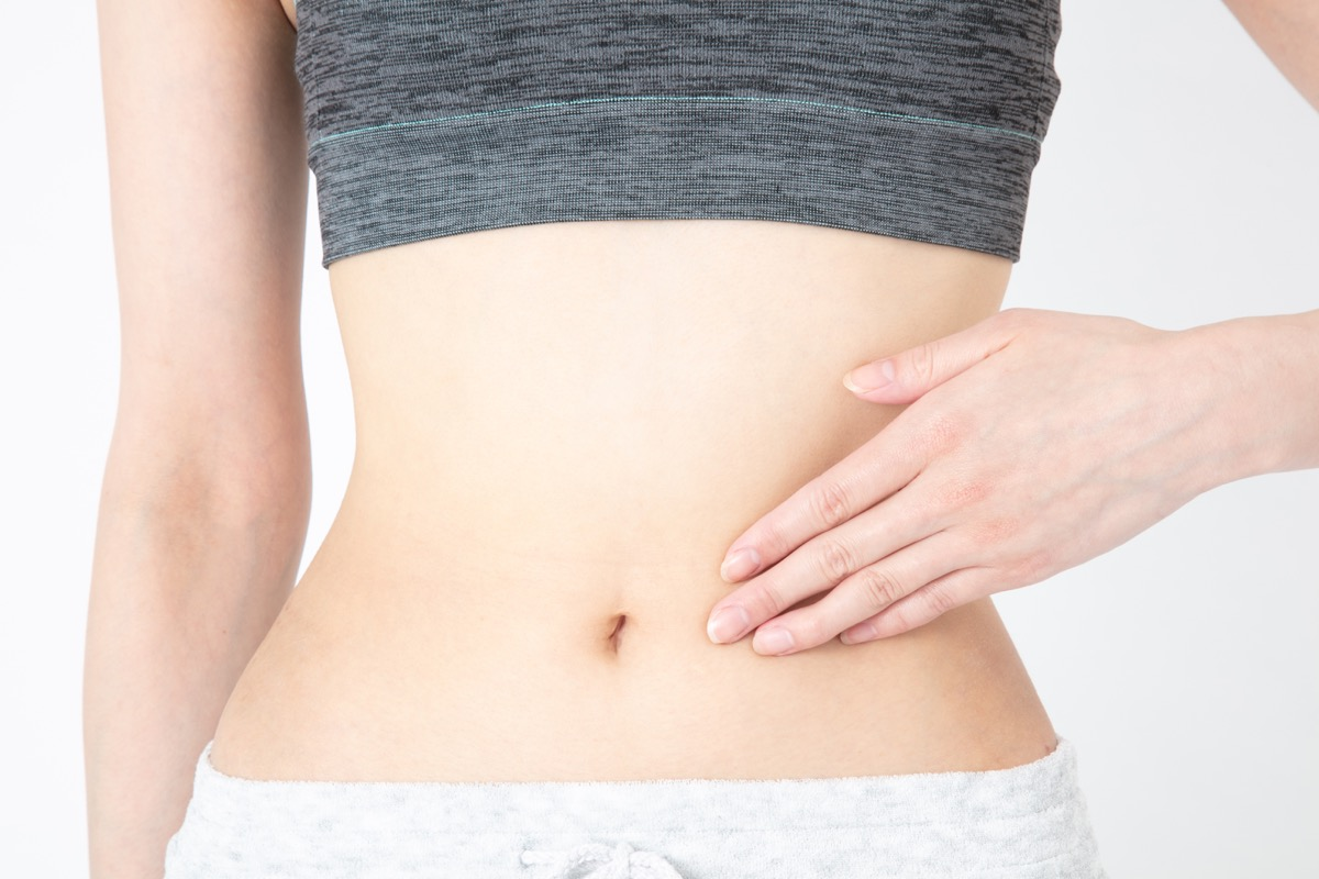 Woman Massaging Belly Button {Pressure Points}