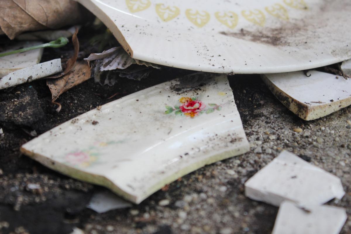 Broken plates on concrete