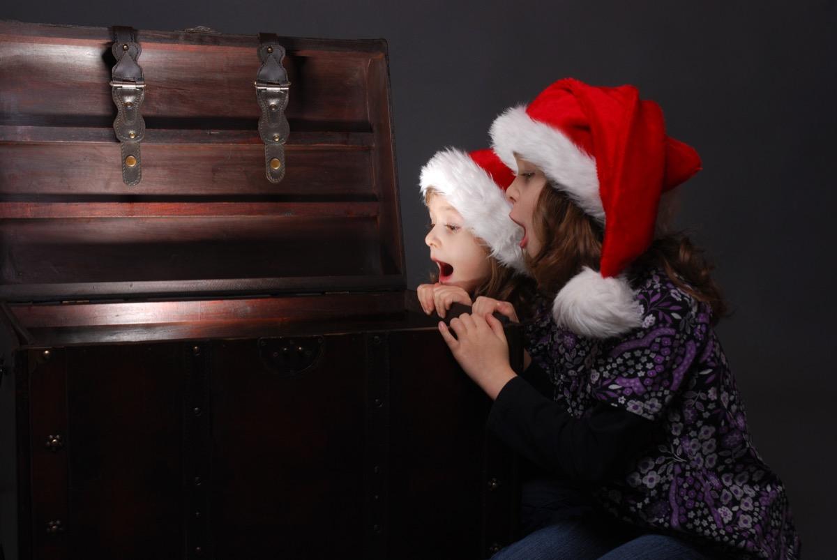 Little girls enjoying a Christmas treasure hunt