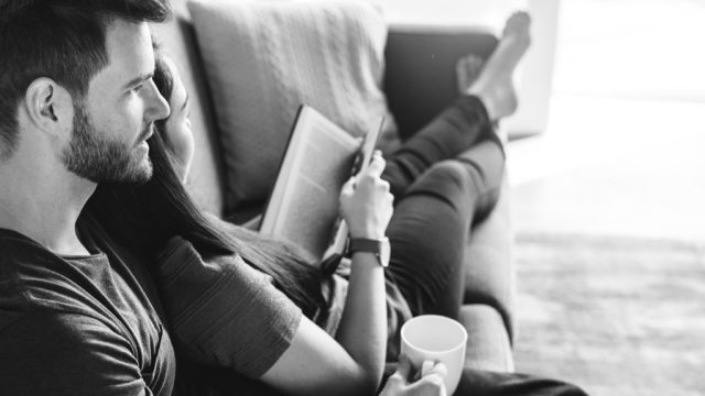 Couple at home reading