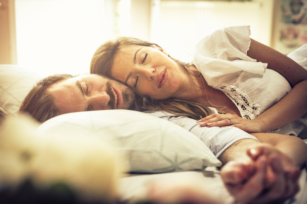 couple in bed sleeping life changes after marriage