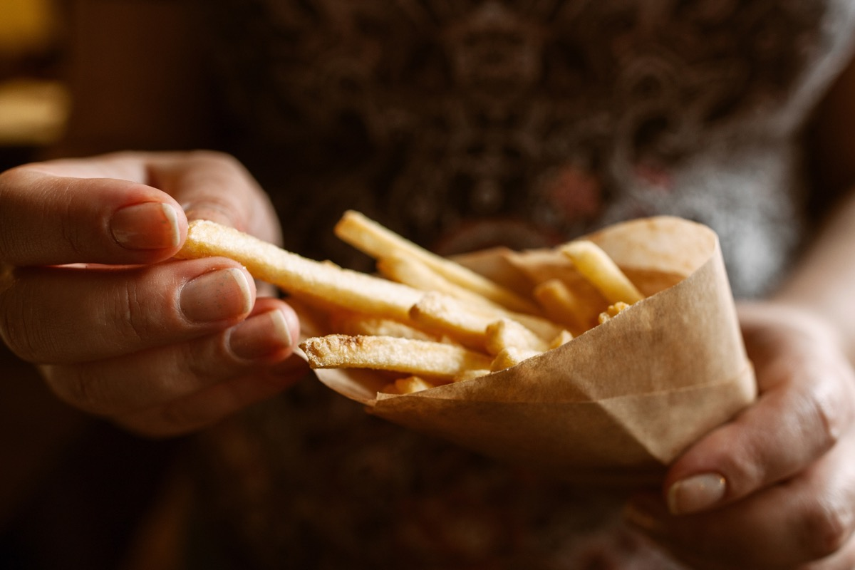 Person eating some salty french fries
