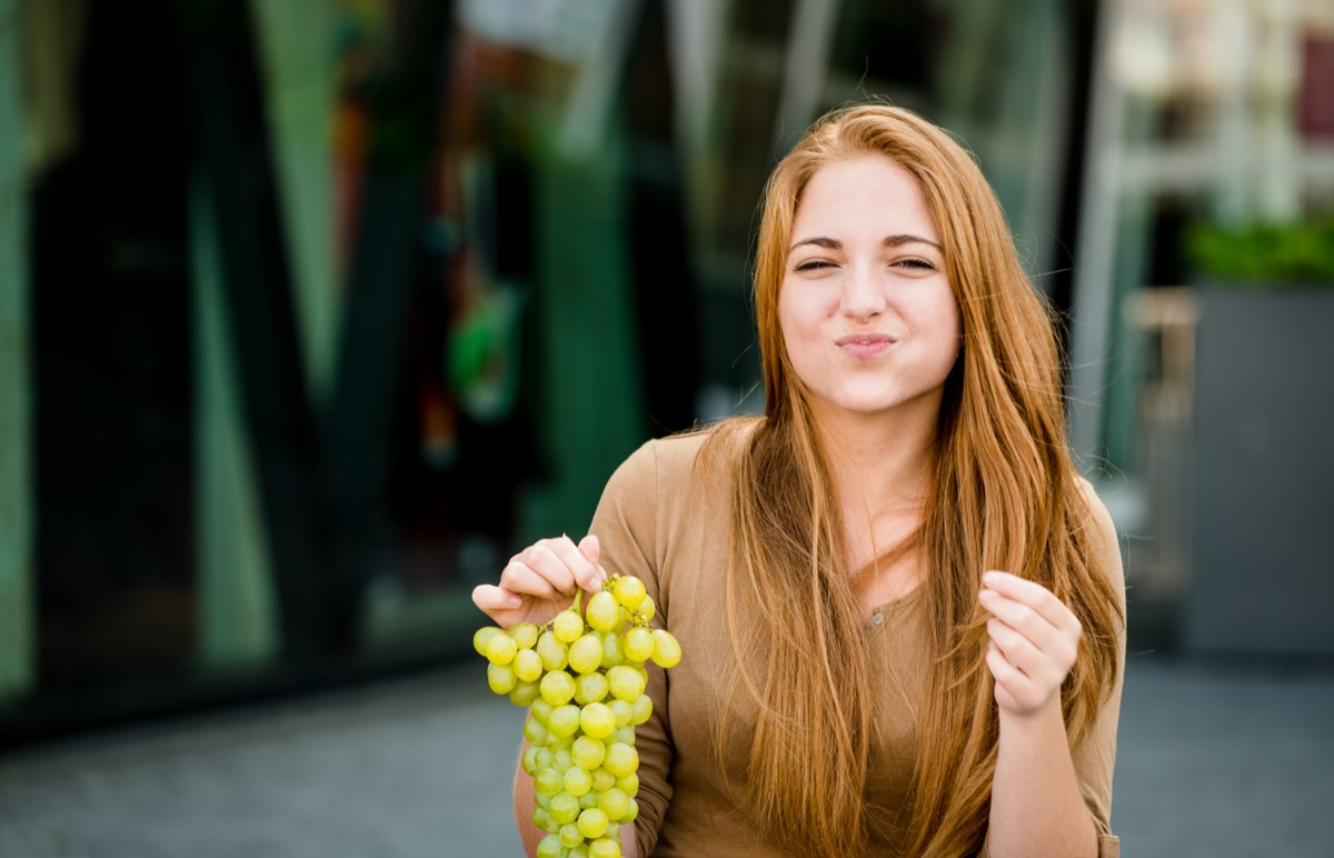 Woman Eating Grapes {New Years Eve Traditions}