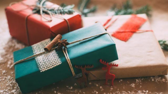 holiday presents wrapped in hipstery wrapping paper