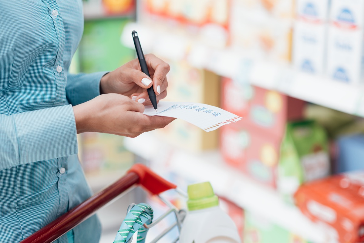 Woman Making a Grocery Shopping List {Shopping Tips}
