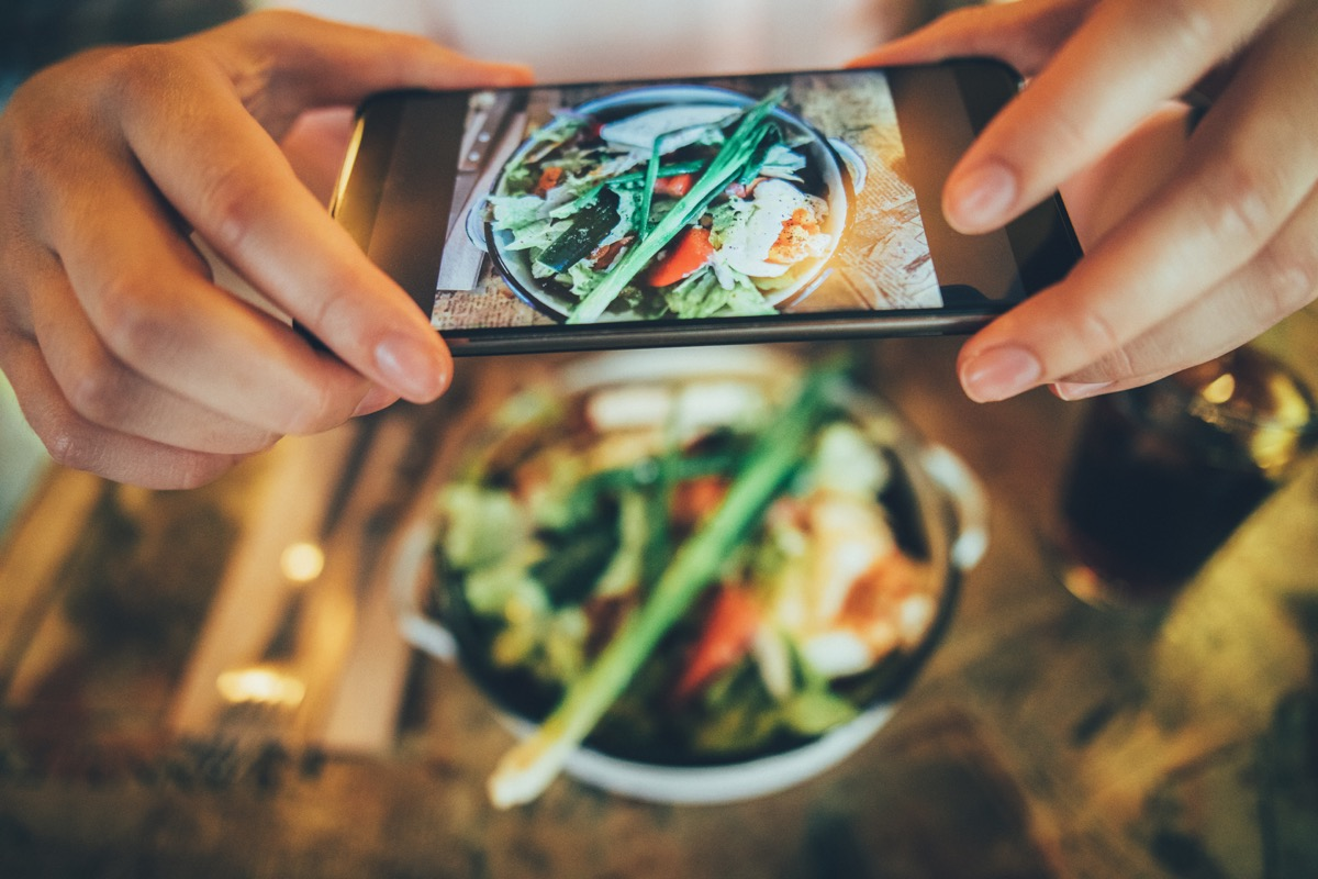 taking a picture of some food with a smart phone.