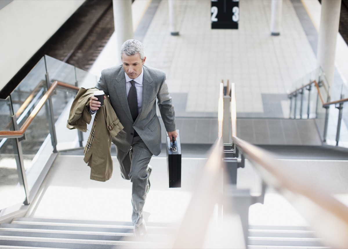 white businessman walking up the stairs