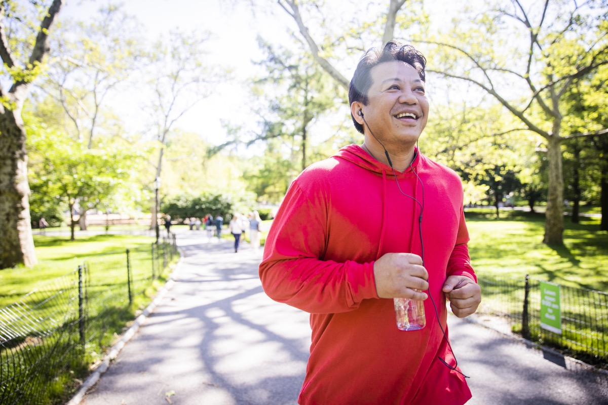 older asian man running in the park