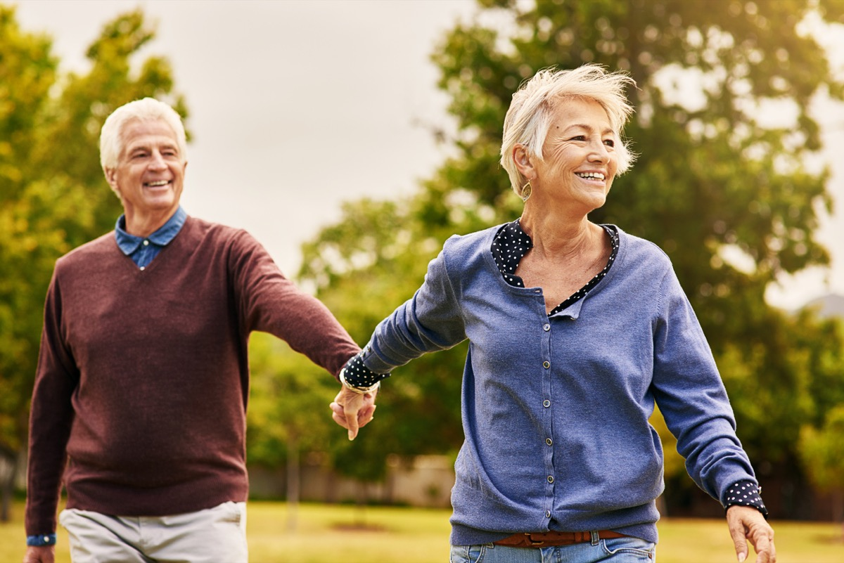 older white man and woman walking outside