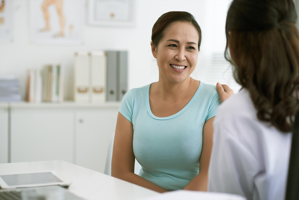 vietnamese woman smiling at her doctor