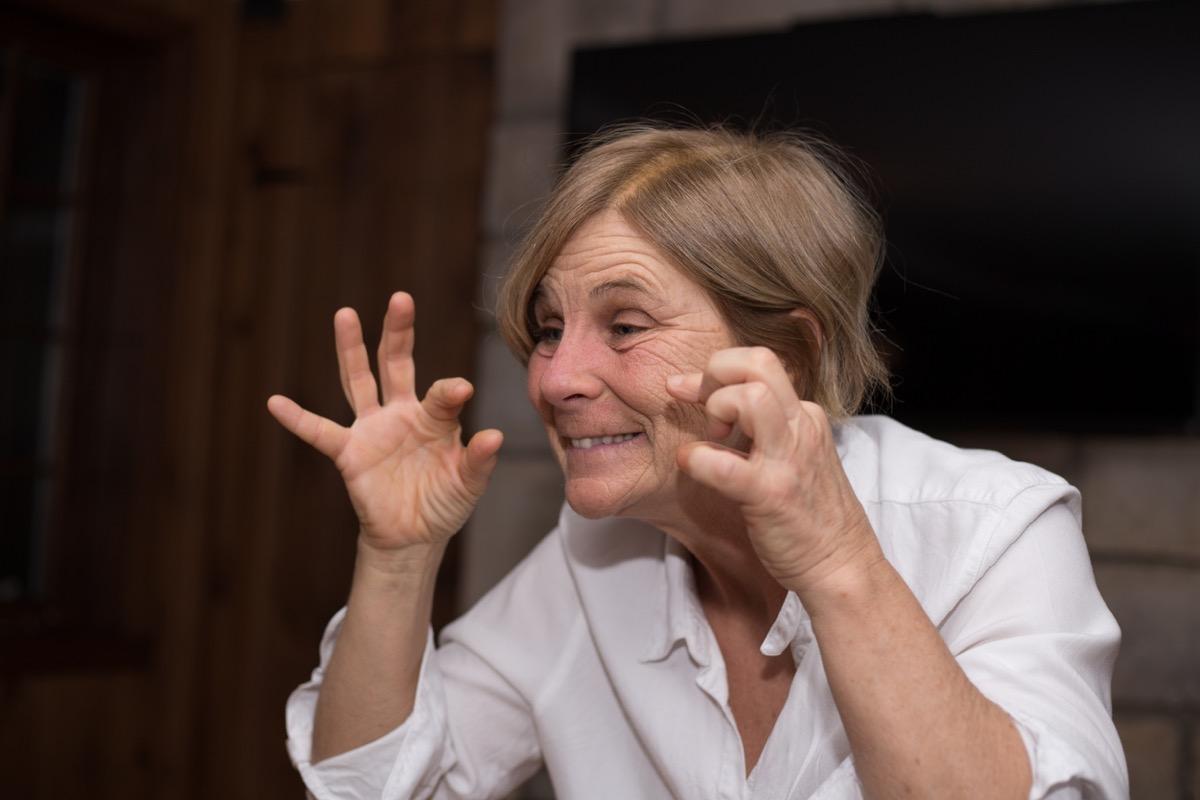 older white woman doing improv