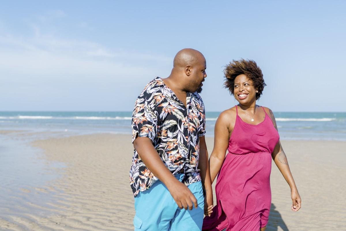 black couple walking on the beach