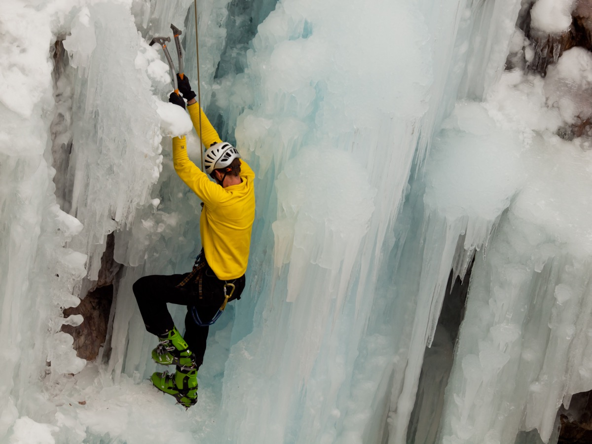 Climber on icy mountain