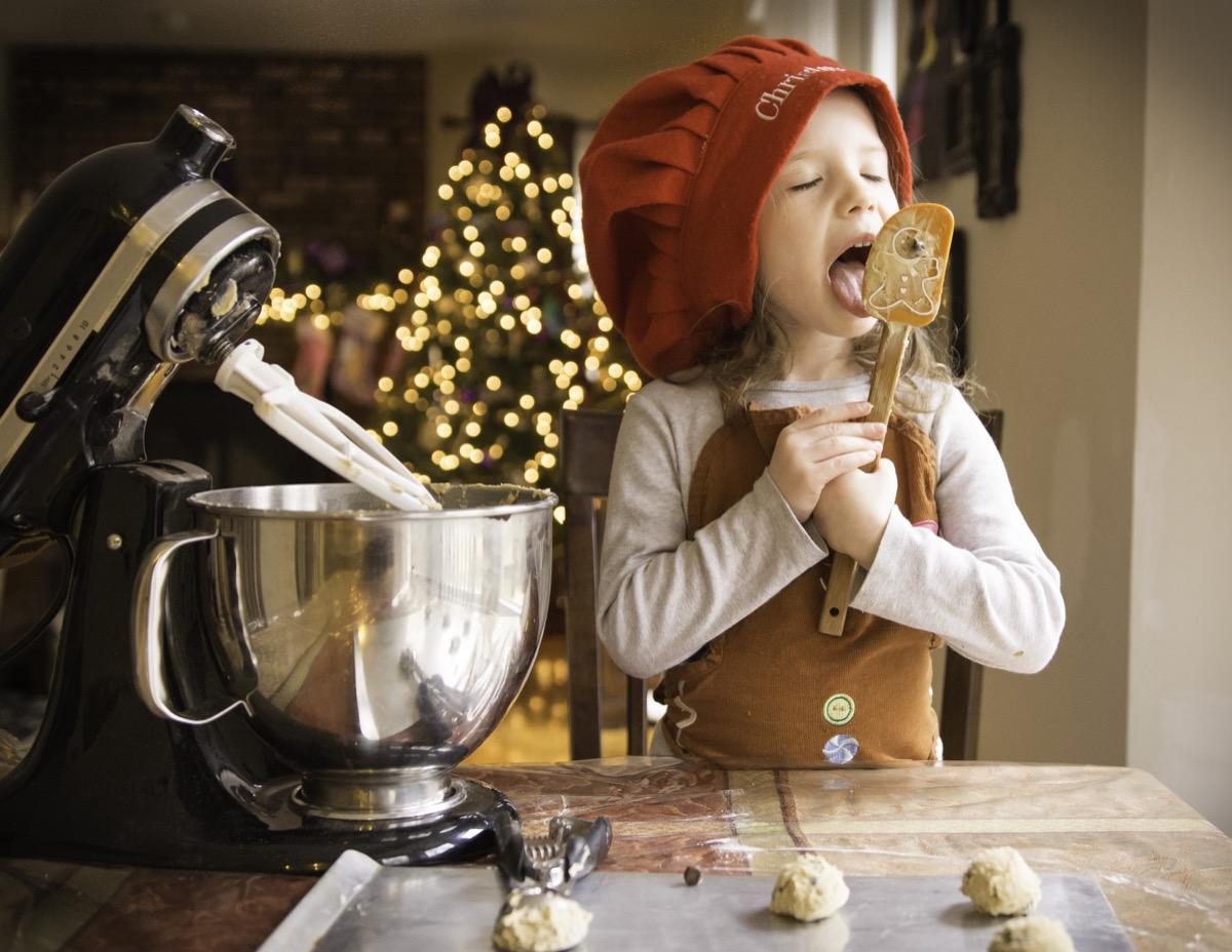 Little girl making cookies on Christmas