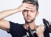 Man at gym frustrated by resolution