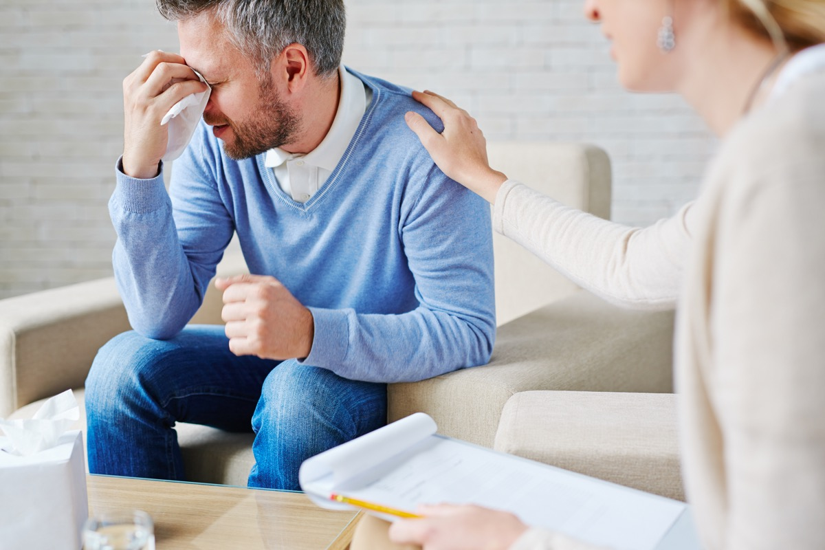 Man Crying in Therapy {Benefits of Crying}