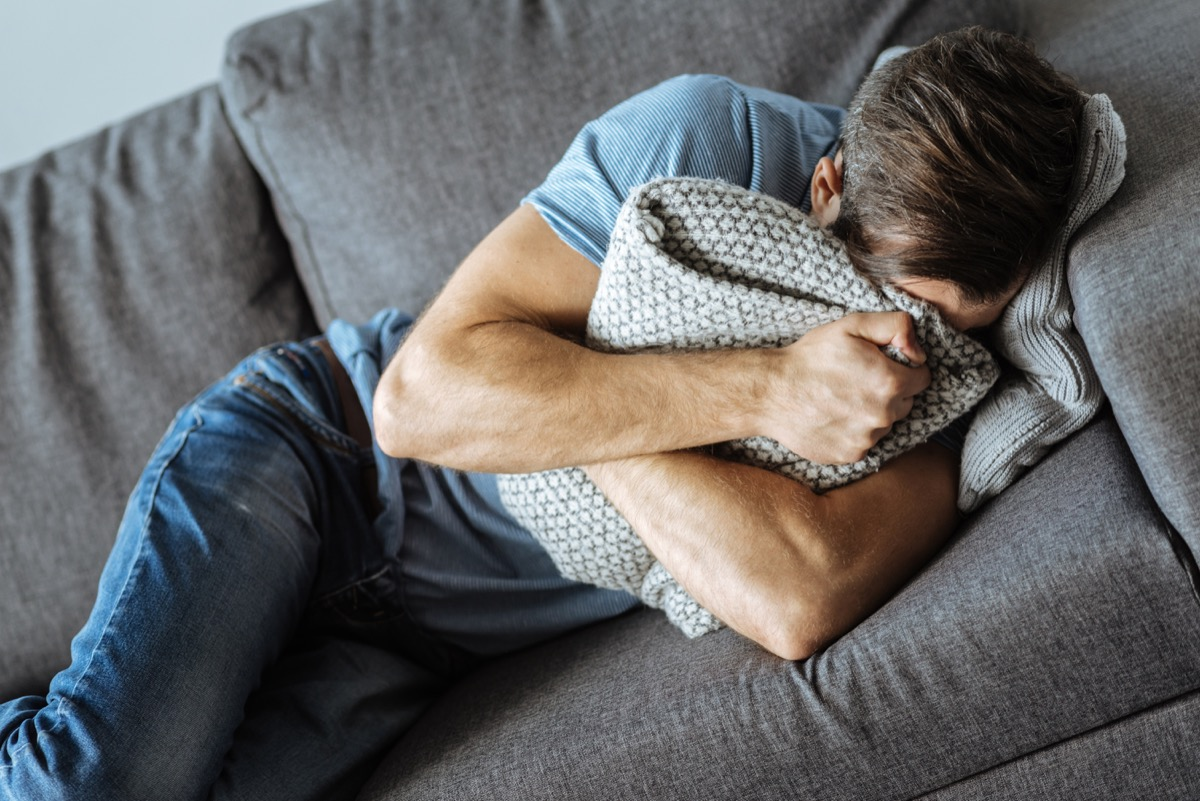 Man on the Couch Crying {Benefits of Crying}