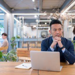 Portrait of a Japanese Businessman using his laptop. Tokyo, Japan