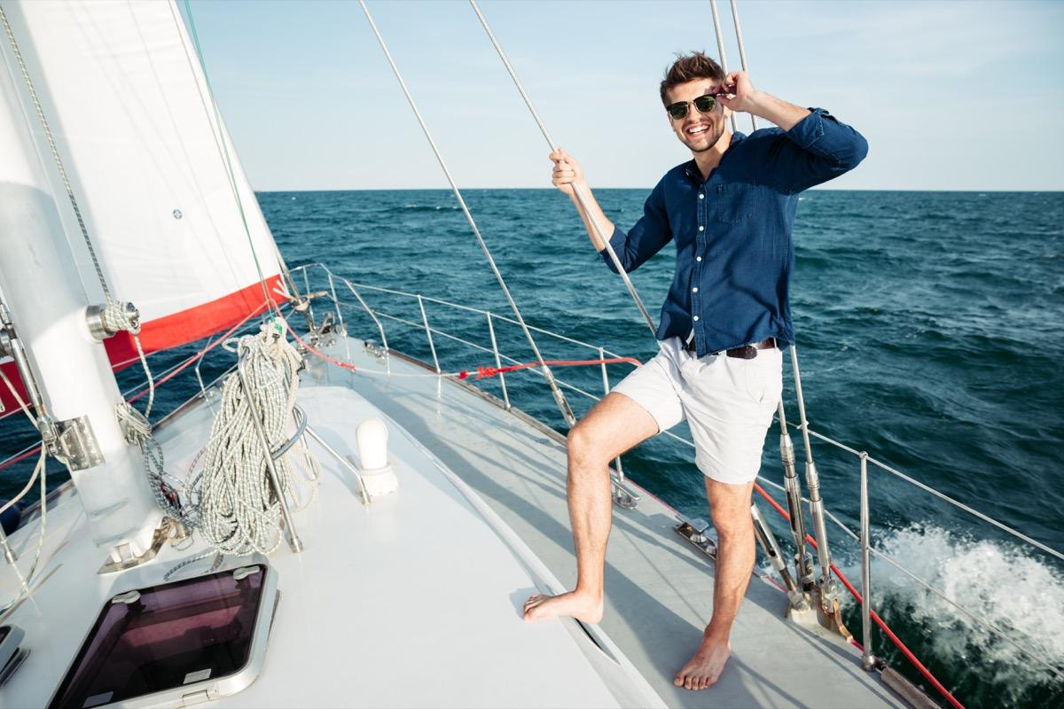 man wearing shorts on a sailboat