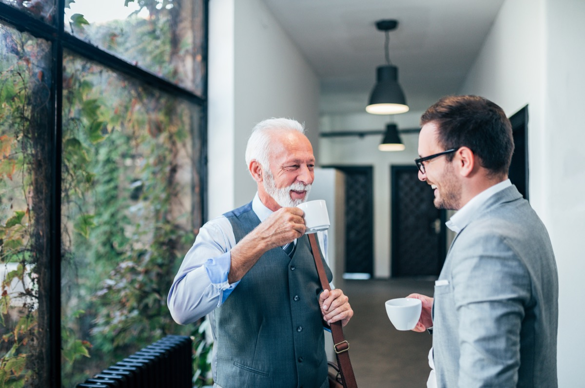 men talking and drinking coffee together