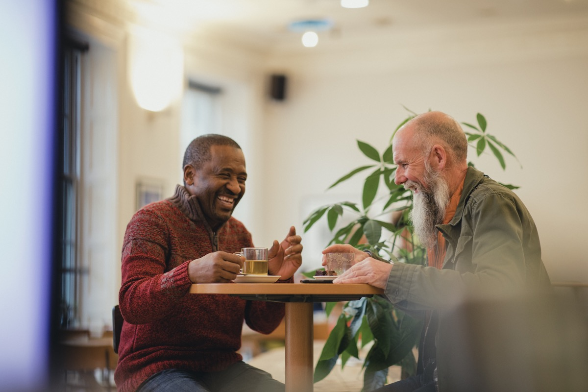 two old friends reconnecting in a coffee shop