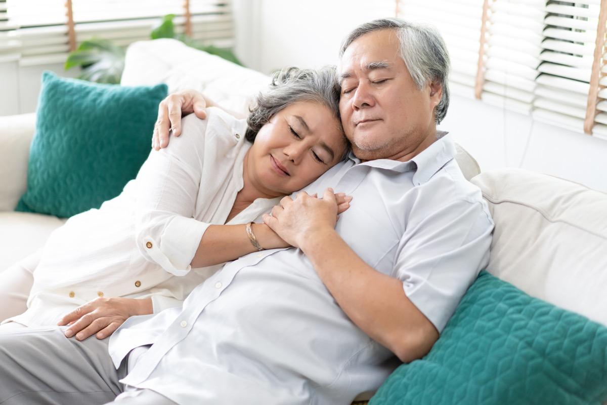 Older couple cuddling smitten