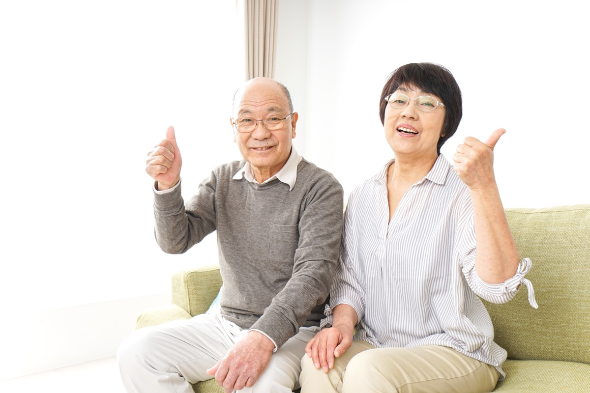 Older couple giving thumbs up