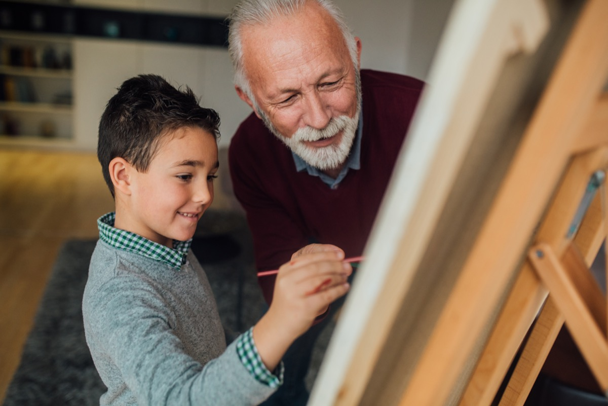 mentor helping a child paint