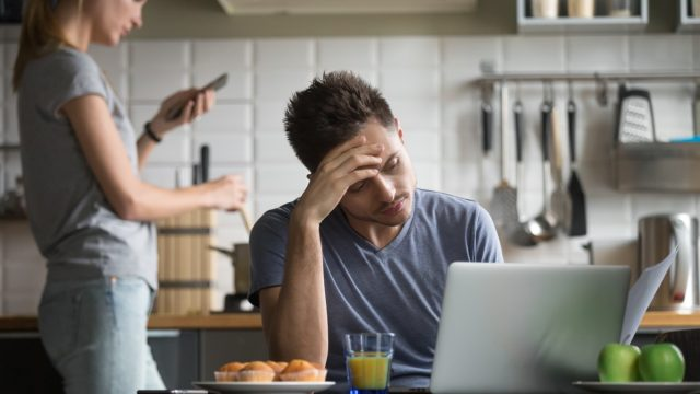 couple ignoring each other in the kitchen, things you should never say to your spouse