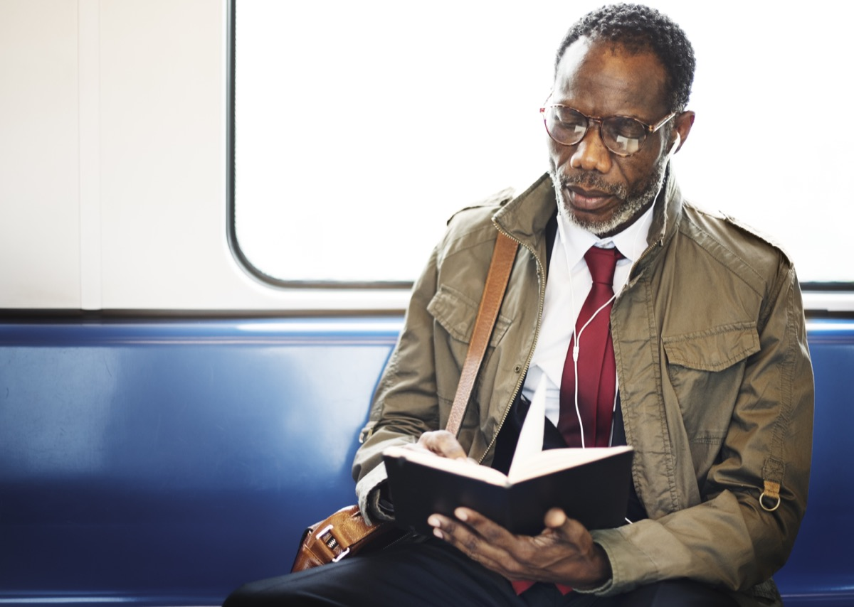 Man Reading on the Subway {Small Resolutions}