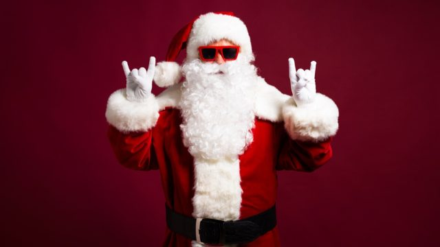 santa claus giving double rock-on sign, things you should never lie to kids about