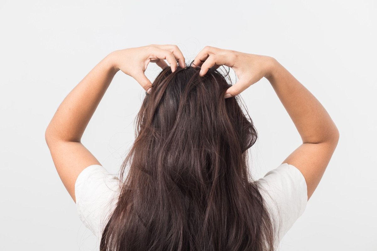 Woman Giving Herself a Scalp Massage {Pressure Points}