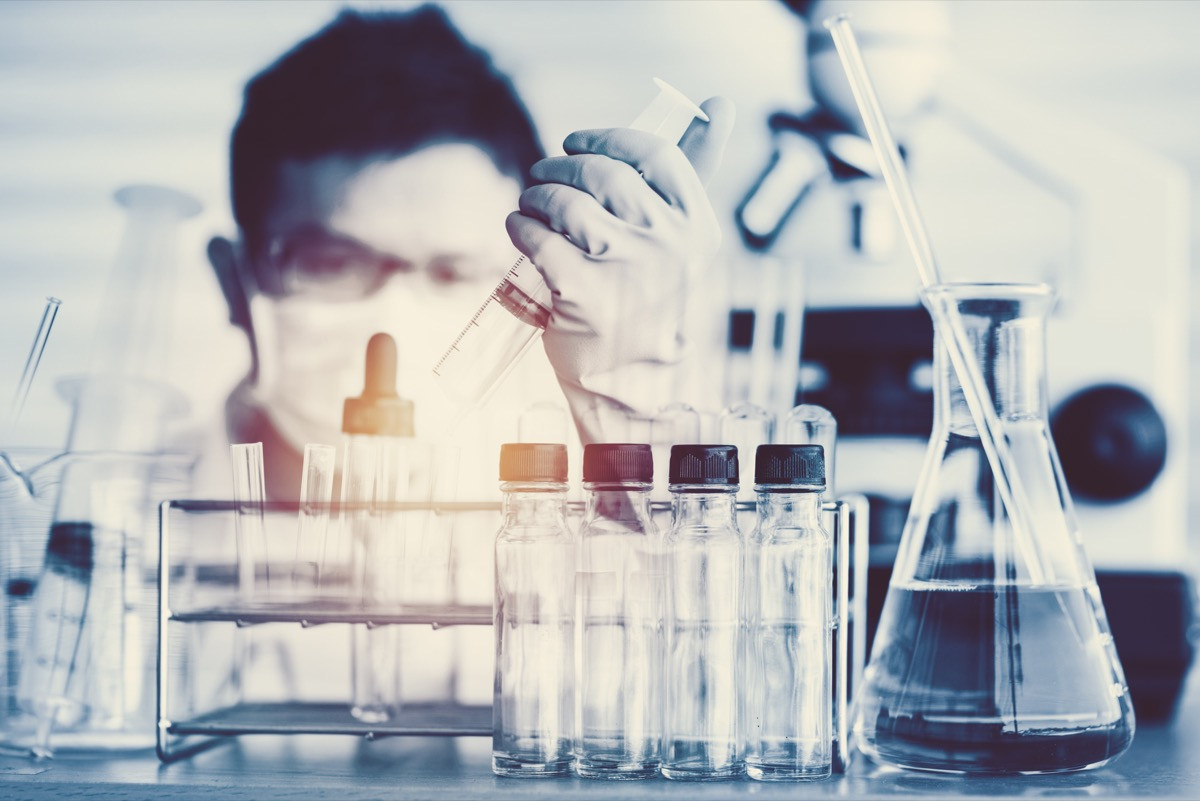 scientist with test tubes in a lab about to make a major breakthrough